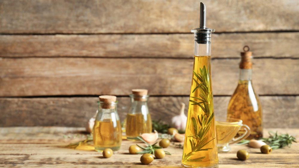 A selection of olive oils and herbs