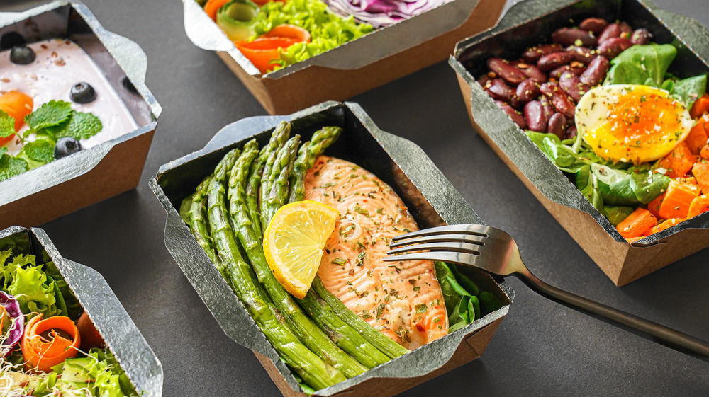 A few healthy meals in containers on a table