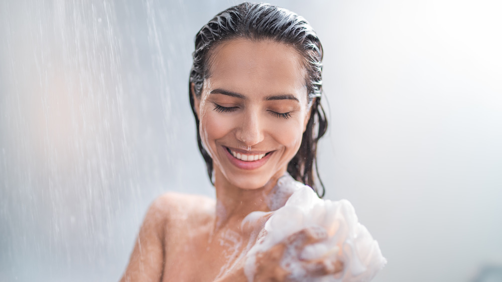 Woman soaping up in the shower