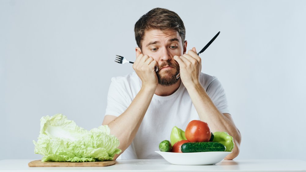 A man bored with his healthy food.